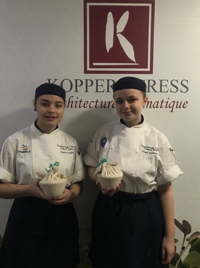 Young student chefs standing in front of Koppert Cress sign